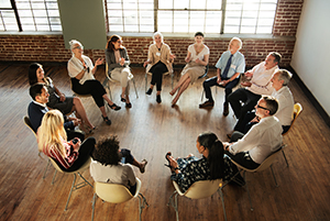 A group of people sitting in a circle